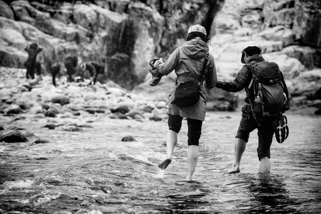 Women in water crossing in Korea