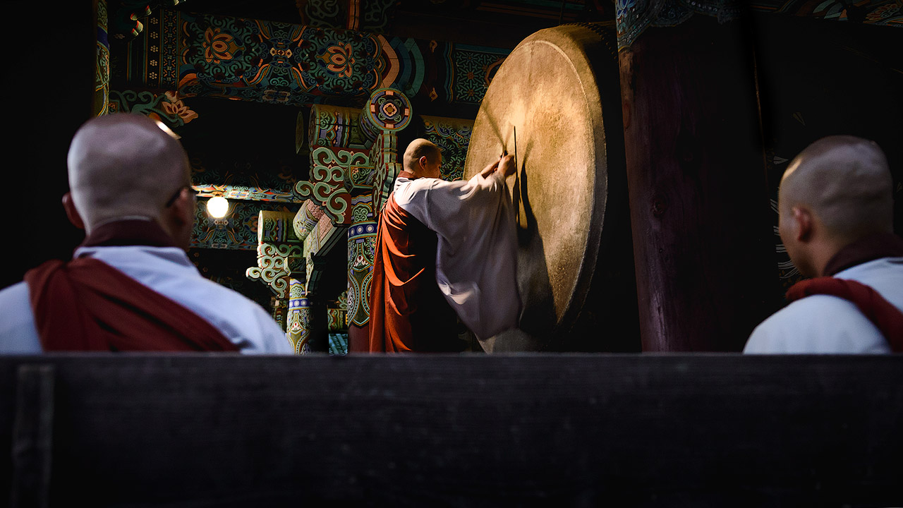 Buddhist monks watching a drum ceremony in South Korea.
