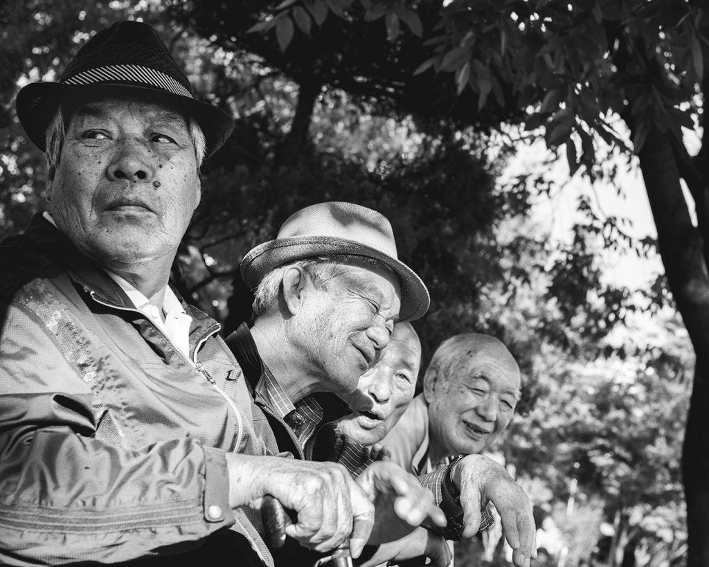 Old men sit together in Gwangju, South Korea
