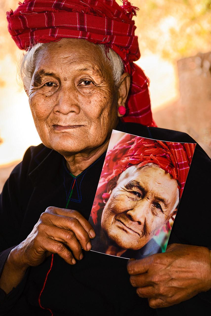 Woman with portrait in Myanmar