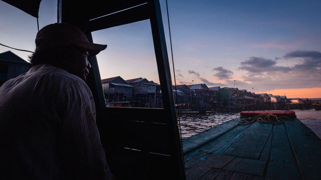 Boatman at sunset in Kampong Phluk