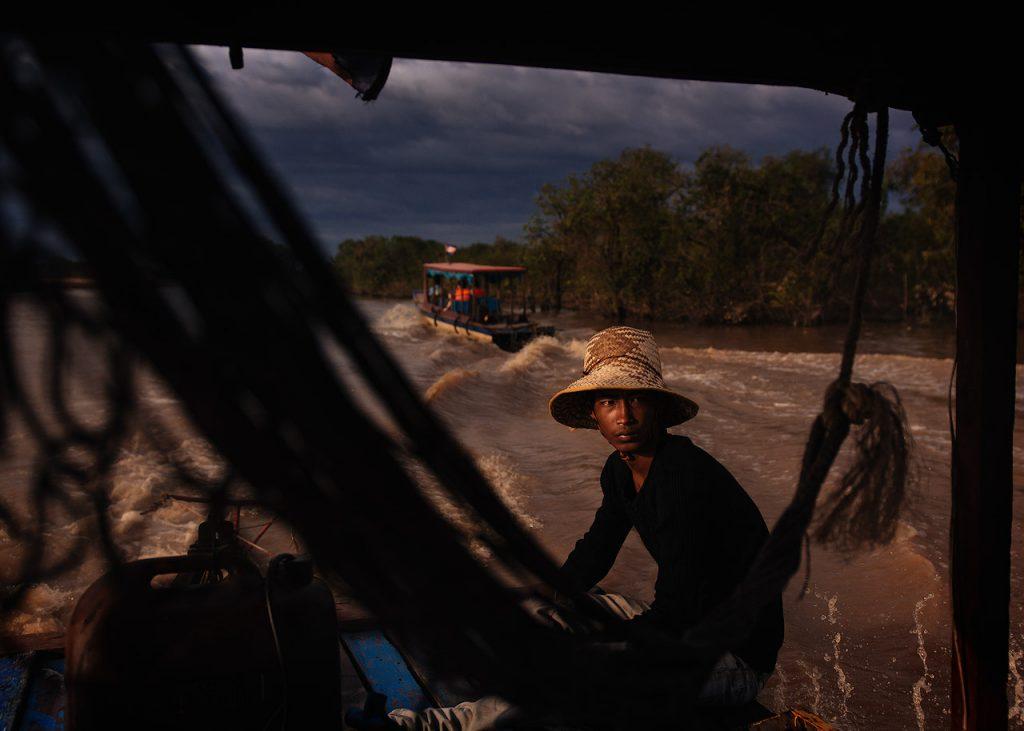 Khmer boatman heading out to the Tonle Sap Lake
