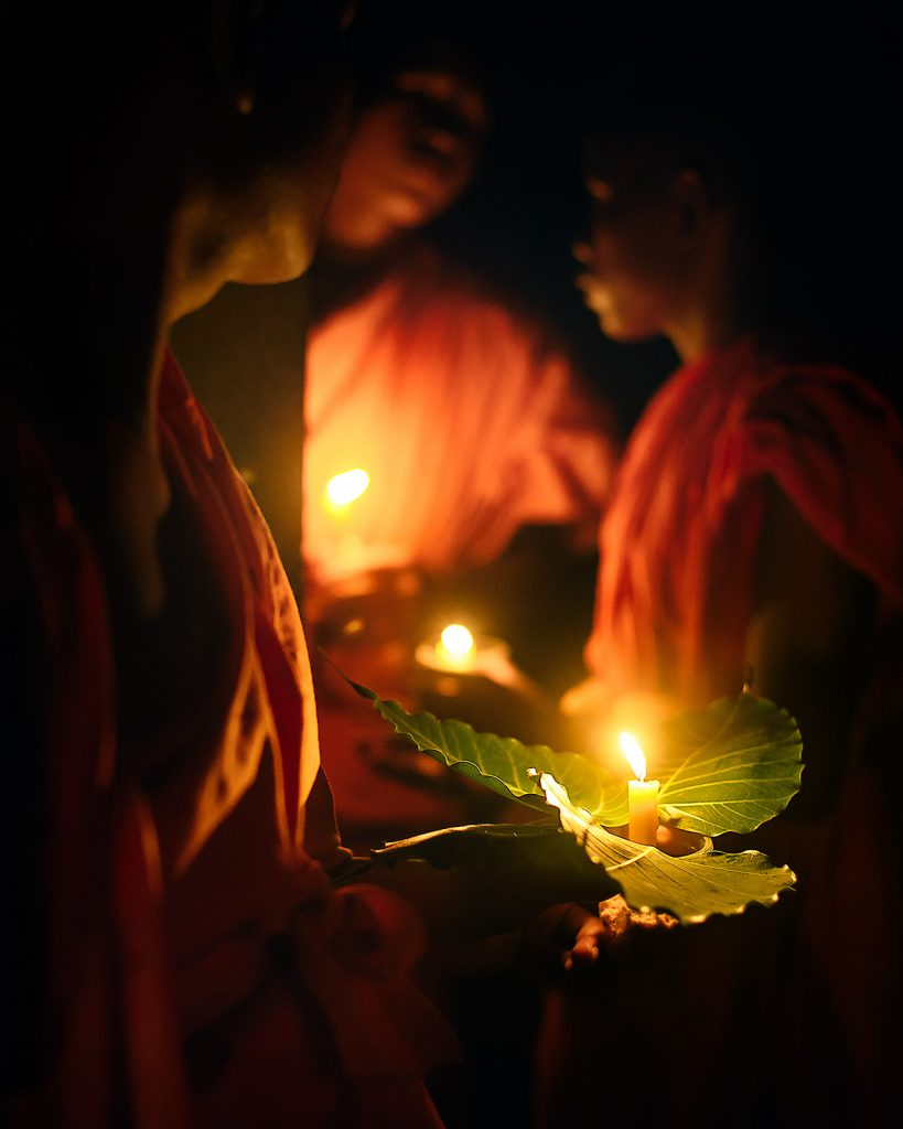 Buddhist monks with candles in the upper sanctuary of Angkor Wat